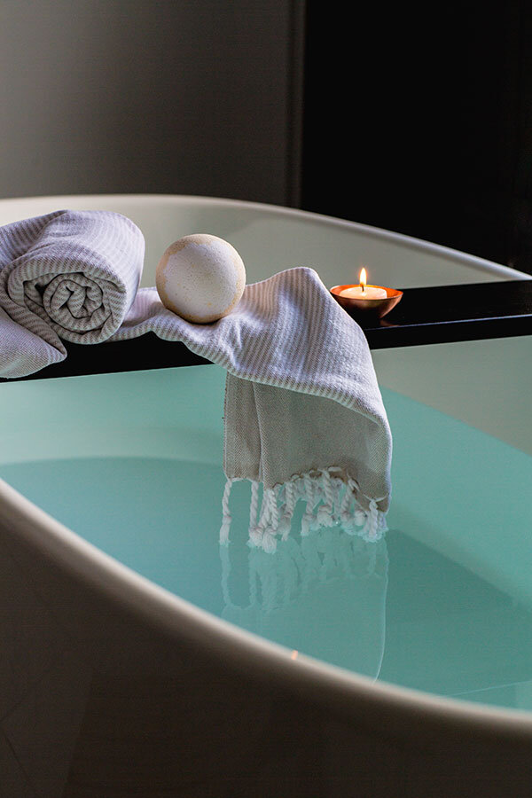 Relaxing bath, towel and candle for wellness and wellbeing