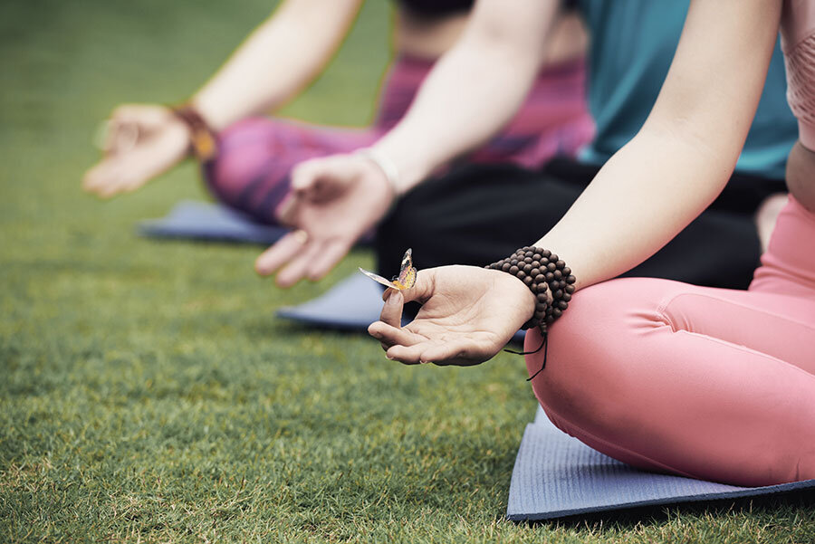 Students Performing Yoga in Oxfordshire with butterfly